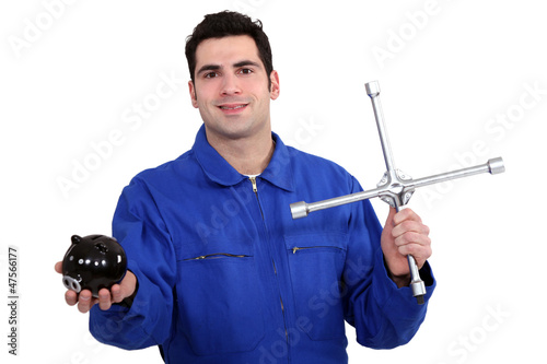Mechanic with key and piggy bank in hand