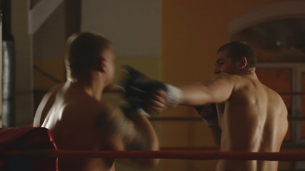 Two men sparring on ring