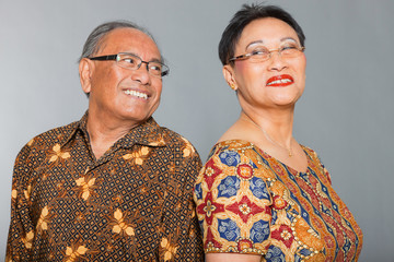 Senior indonesian couple in love. Traditional clothing. Studio.