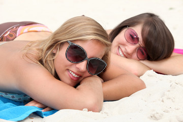 Two teenage girls sunbathing