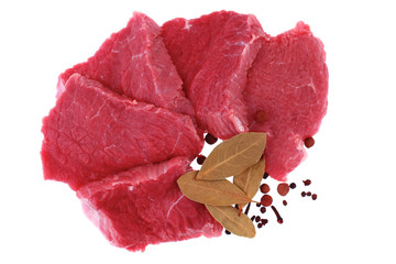 Cut of  beef steak  with  laurel and  flavouring. Isolated.