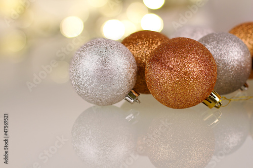 Christmas baubles over shiny lights background