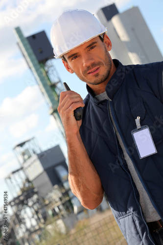 Worker on site with a walkie talkie