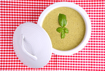 basil cream soup  on a checked table cloth
