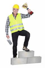 Successful laborer on a podium