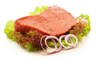 Composition with piece of beef meat and lettuce