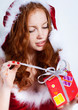 Redhead girl with presents