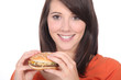 Young woman eating burger