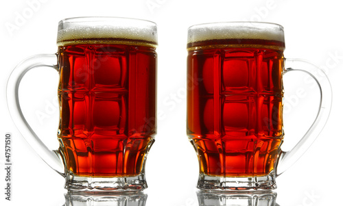 two tankards of kvass, isolated on white