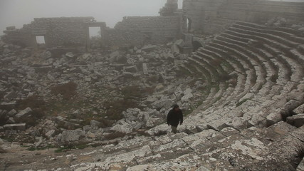 Man climbing stairs in ancient amphitheater