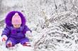 Portrait of happy little girl in snowy landscape