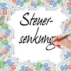 Hand mit Stift schreibt Steuersenkung