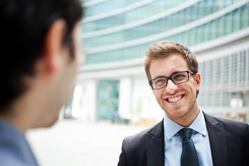 Businessmen outdoor meeting