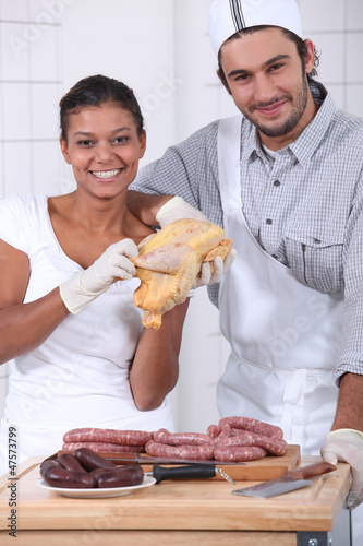 two butchers cutting fresh meat
