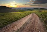Fototapety Dirt Road In Meadow At Daybreak