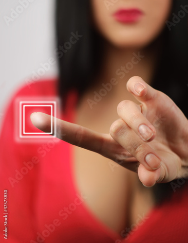 lady presses the touch screen