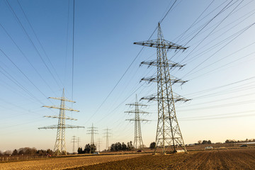 hight voltage tower in rural landscape with blue sky