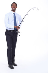 Man in a shirt and tie using a fishing rod