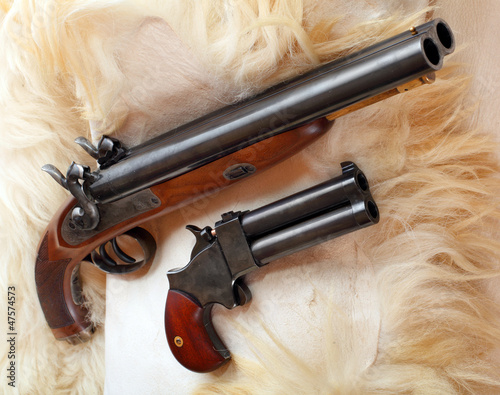 Vintage large-bore pistols. British colonial weapons.