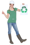 Tradeswoman holding the recycling symbol