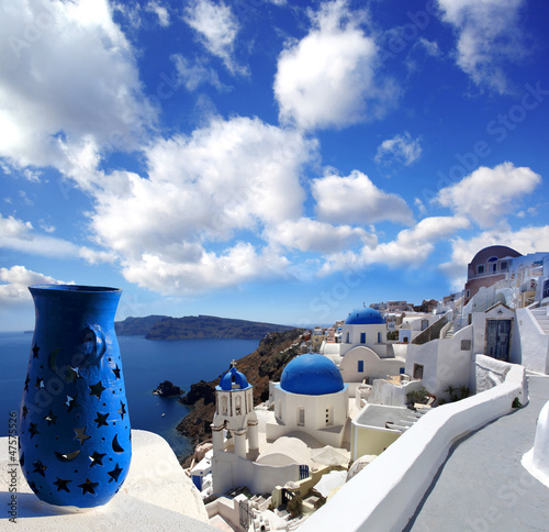 Santorini with  old architecture, churches against sea in Greece