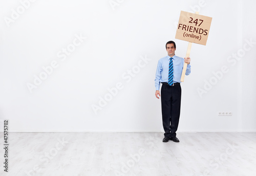 Lonely businessman with many online friends