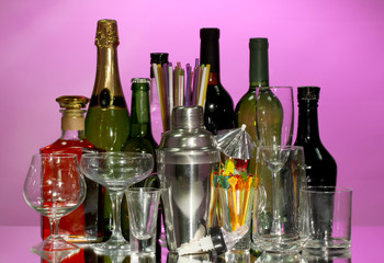 Collection of various glasses and drinks on color background