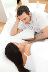 couple in bed talking