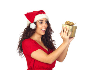 Surprised pretty woman in Christmas with a gift