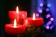 Christmas candles with blurry lights on background