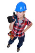 Woman holding a cordless drill