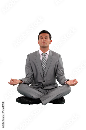 Businessman sat in lotus position