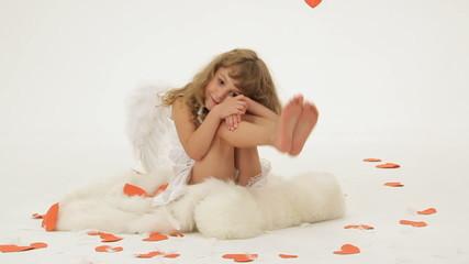 Little girl dressed as angel posing for camera