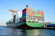 Green cargo ship in seaport - 47579944