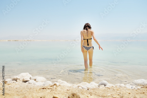 Young woman going to water