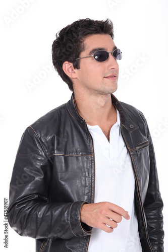 young man wearing leather jacket and sunglasses