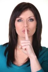 Woman putting her finger to her lips asking for silence