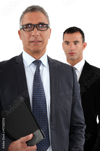 Businessman with young apprentice