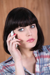 a brunette woman at phone