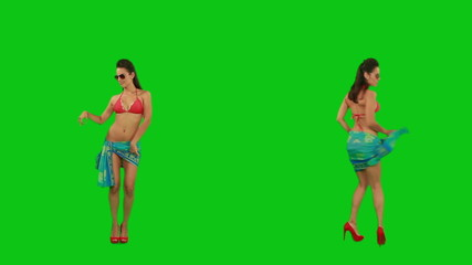 Beautiful girl in pareo dancing against green screen