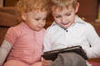 Two kids with digital tablet