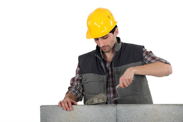 Man with trowel and cement
