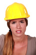 Concerned woman in a hardhat