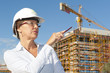 Portrait woman architect construction site