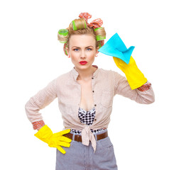 Funny young housewife with gloves holding rag, isolated on white
