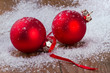 red balls  with snowflakes, on wooden background