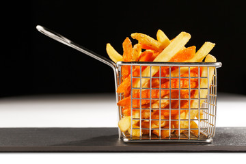 A beautiful basket of fried chips also known as French Fries