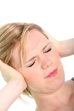 Woman with a migraine holding her head