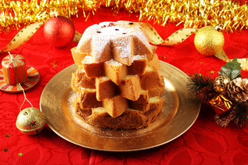 Pandoro Christmas cake on decorated red table