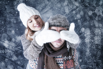 Happy young couple   covering  snow background.fooling around.